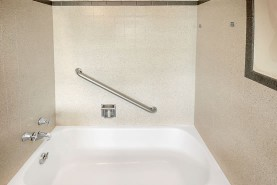 We saved this homeowner thousands by refinishing the tub and surrounding tile!